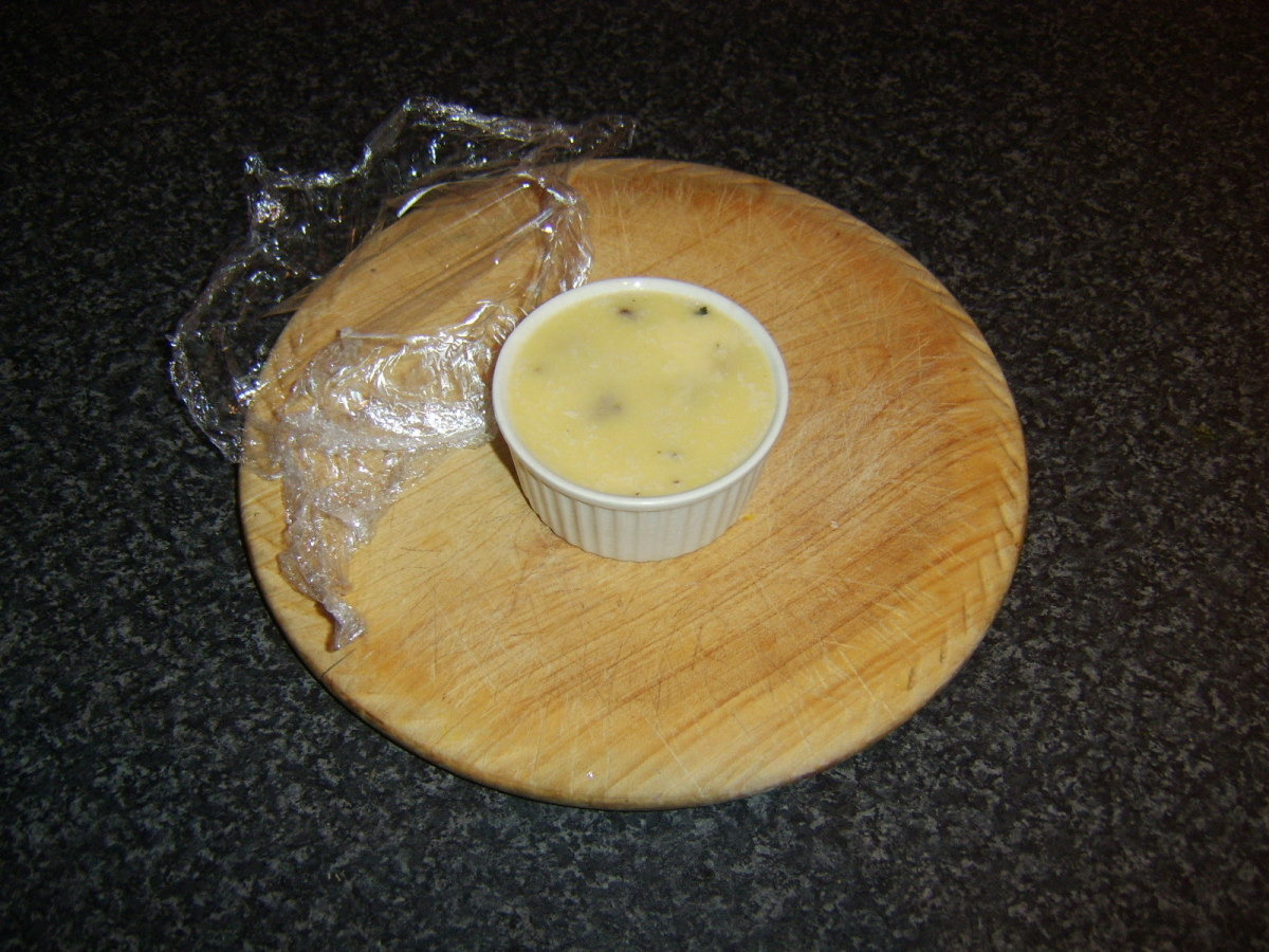 The chunky chicken liver pate has been refrigerated overnight and is now ready to serve.