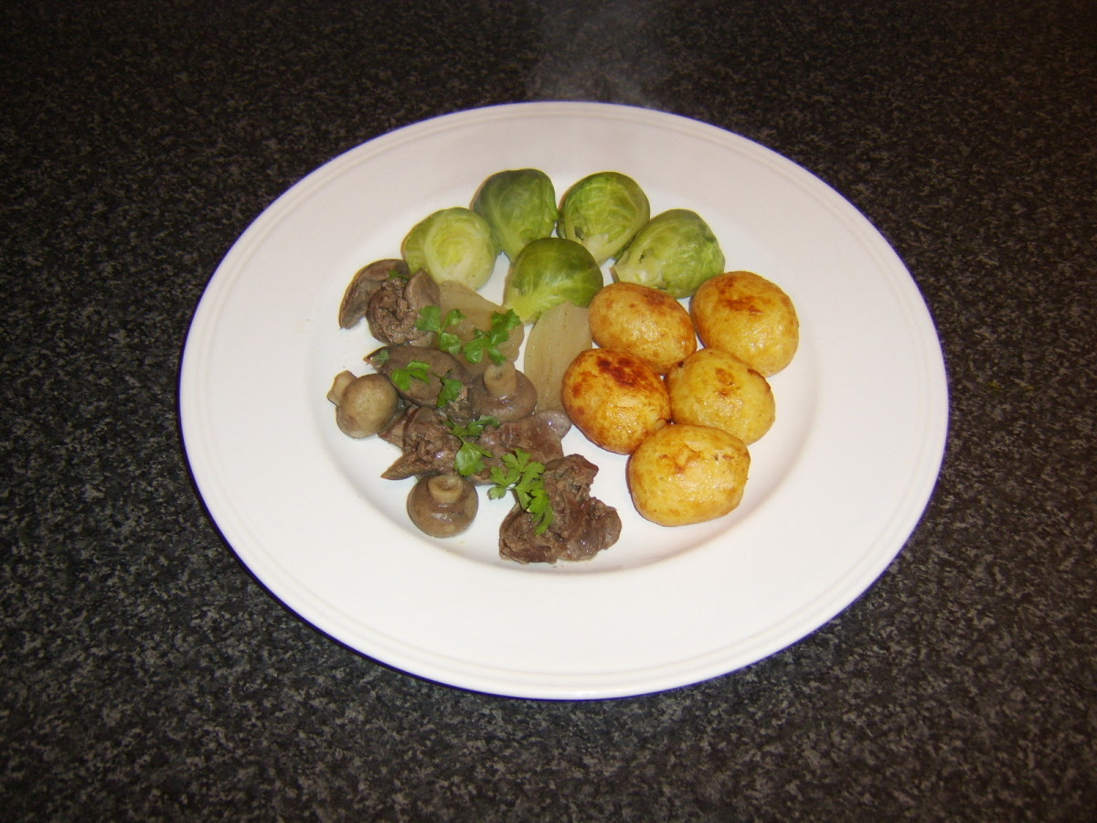 Chicken liver and mushroom casserole, served with pan roasted baby new potatoes and Brussels sprouts