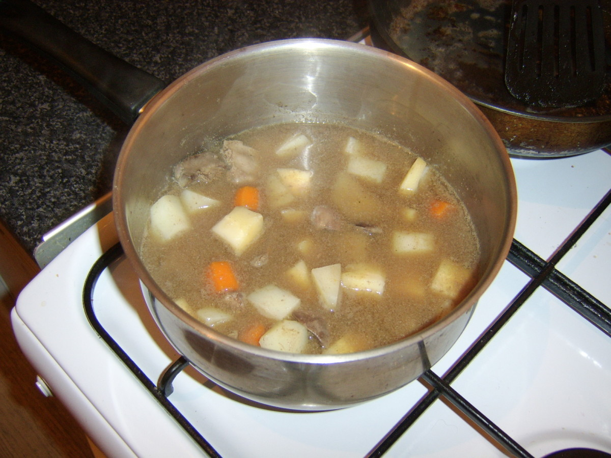 Chicken livers, vegetables and stock are added to a large stew pot