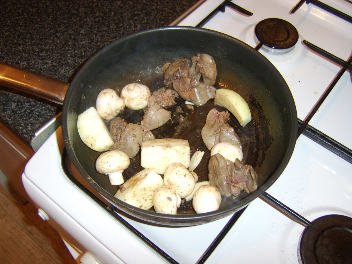 Mushrooms and onion are briefly added to the pan