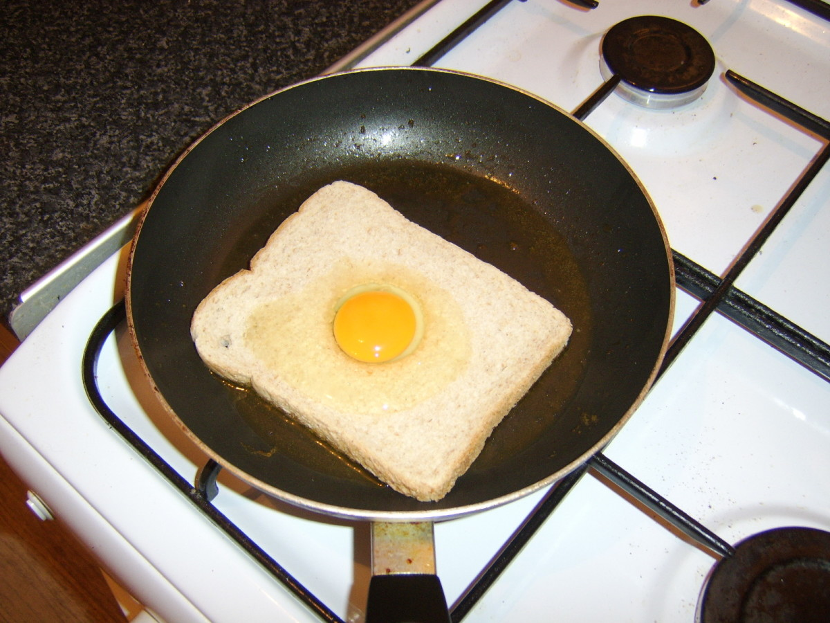 The egg is poured on to the bread that the yolk slips in to the hole