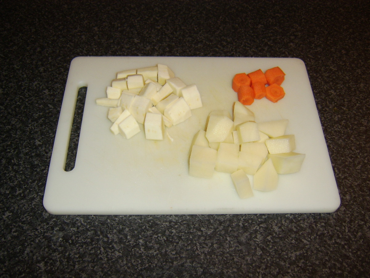 Carrot, parsnip and potato are peeled and chopped