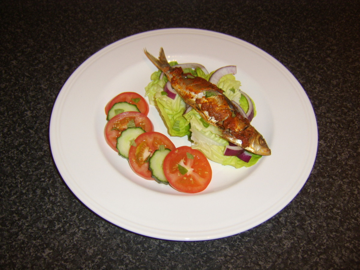 Red pesto sauce is rubbed on to the sardine before it is baked and served with a simple salad