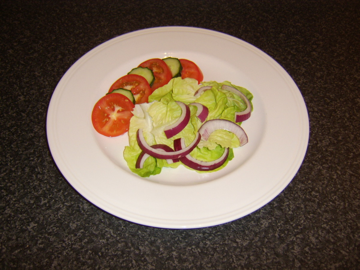 Simple salad accompanies the baked sardine