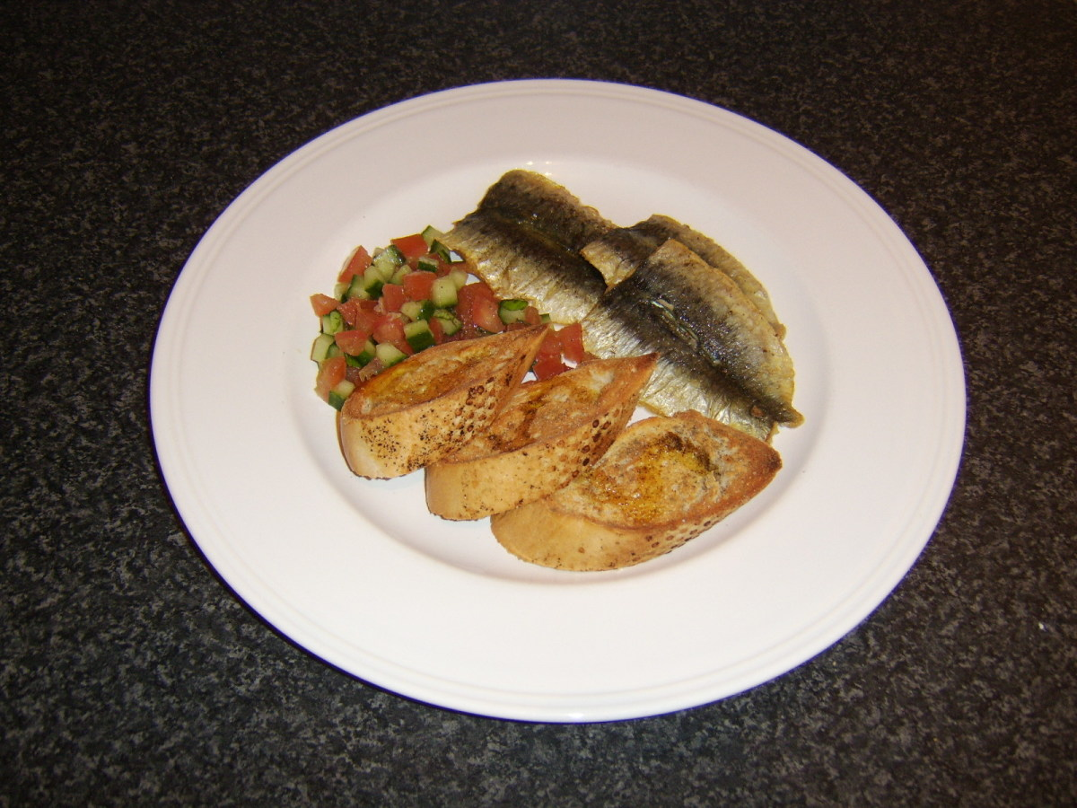 These sardine fillets are gently fried in olive oil and served with a very simple tomato and cucumber salsa and bruschetta