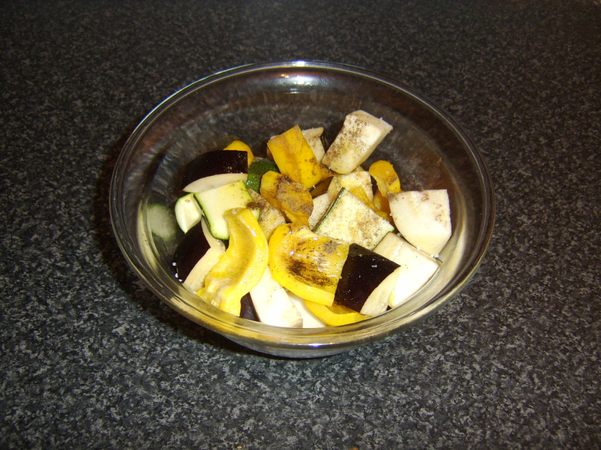 Vegetables are chopped, seasoned and stirred in olive oil