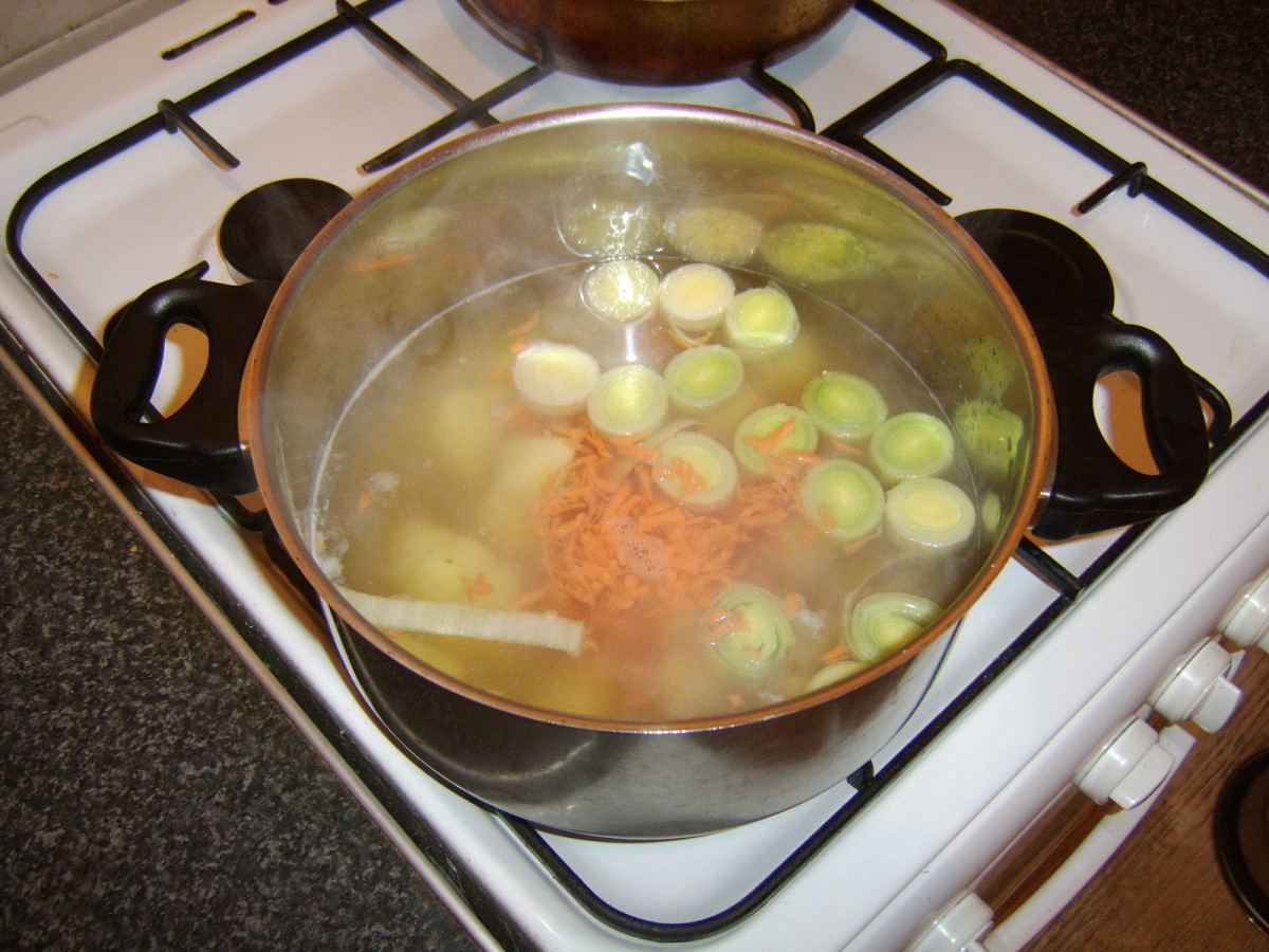 Prepared vegetables are added to the chicken broth