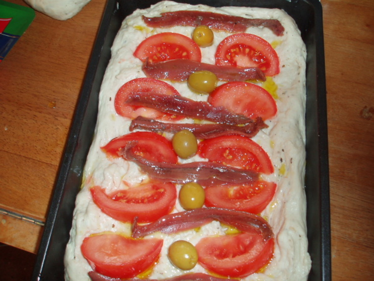 with anchovies and tomatoes