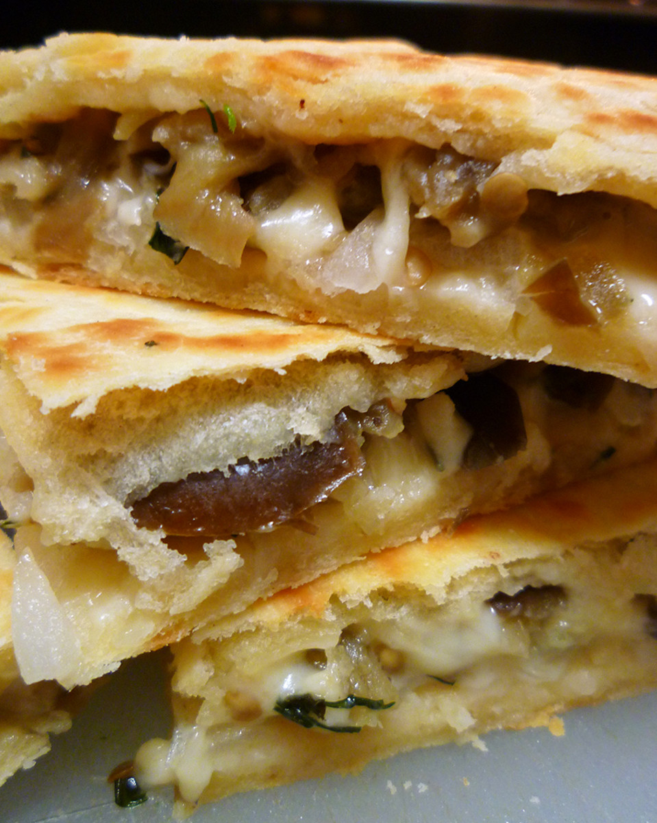 A stack of eggplant quesadillas.