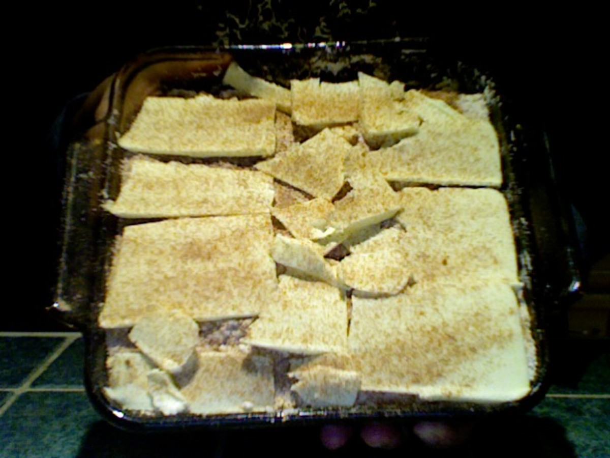 I did my best to evenly cover the mixture with my butter slices. Optional: Add a very light layer of cinnamon and sugar over the butter slices before baking.
