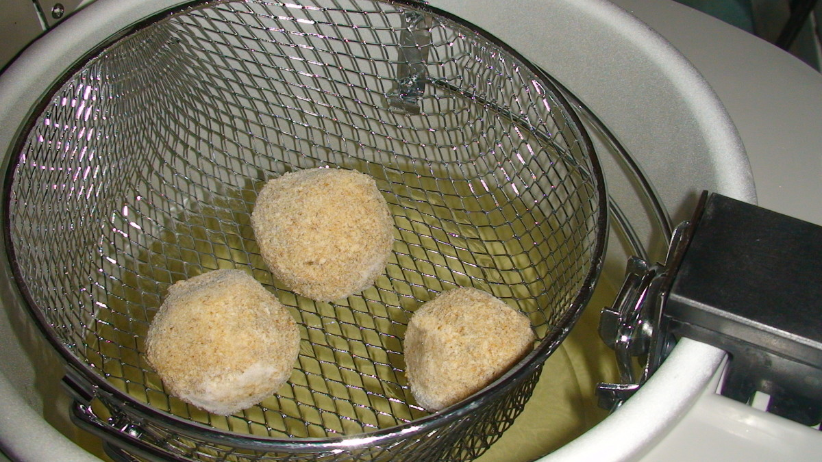 Frozen croquettes placed in deep fryer set at 350 degrees.