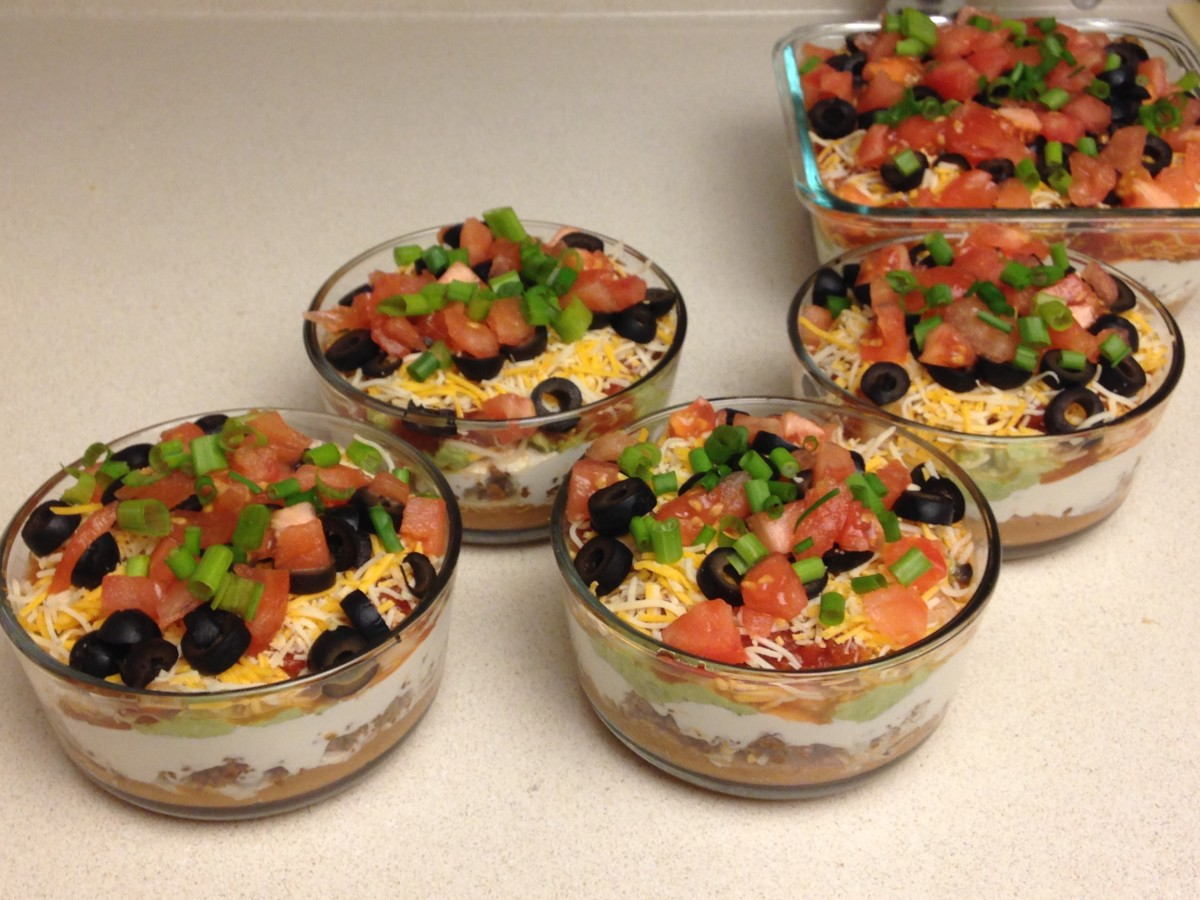 What's better than a big dish of 10-layer Mexican dip? How about multiple smaller servings?  Shown are 4 two-cup portions and 1 four-cup square dish.