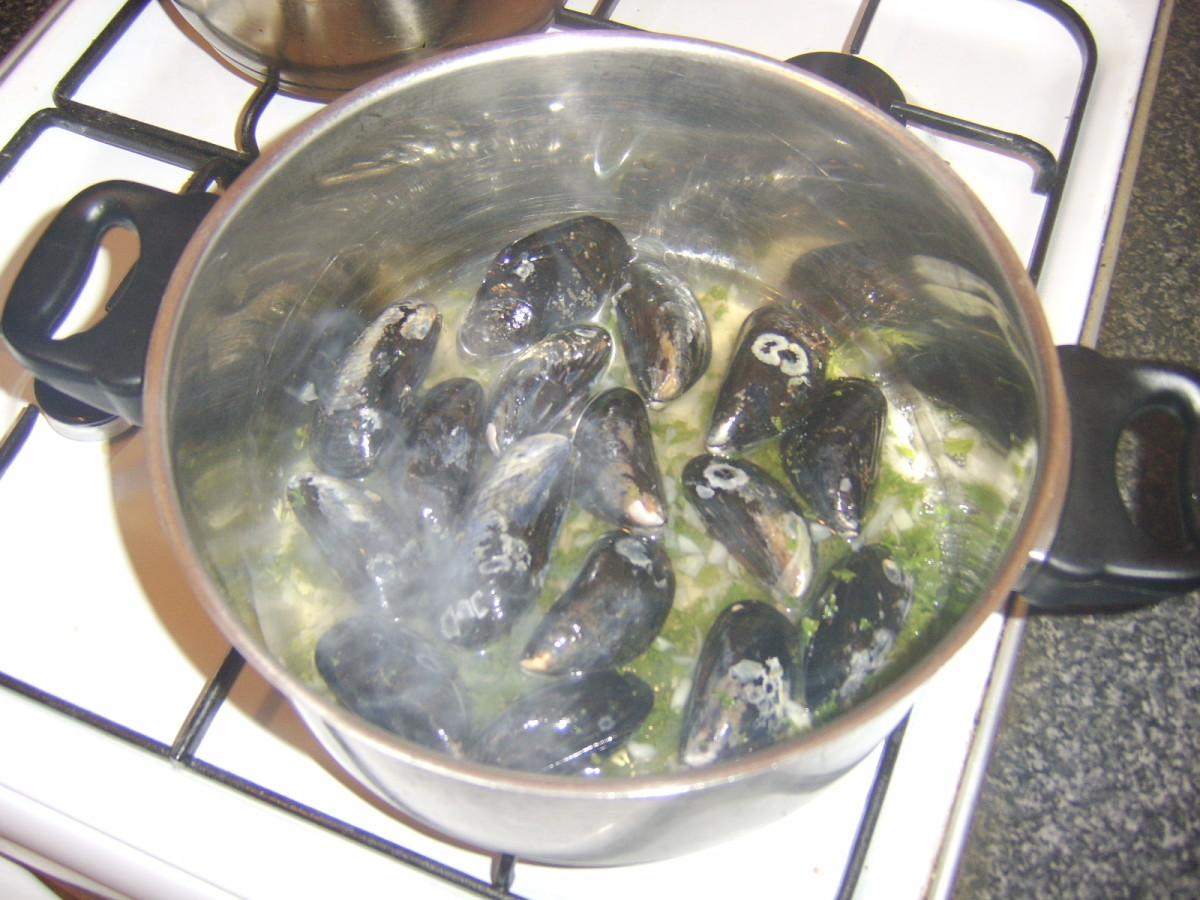 Mussels are added to the boiling liquid