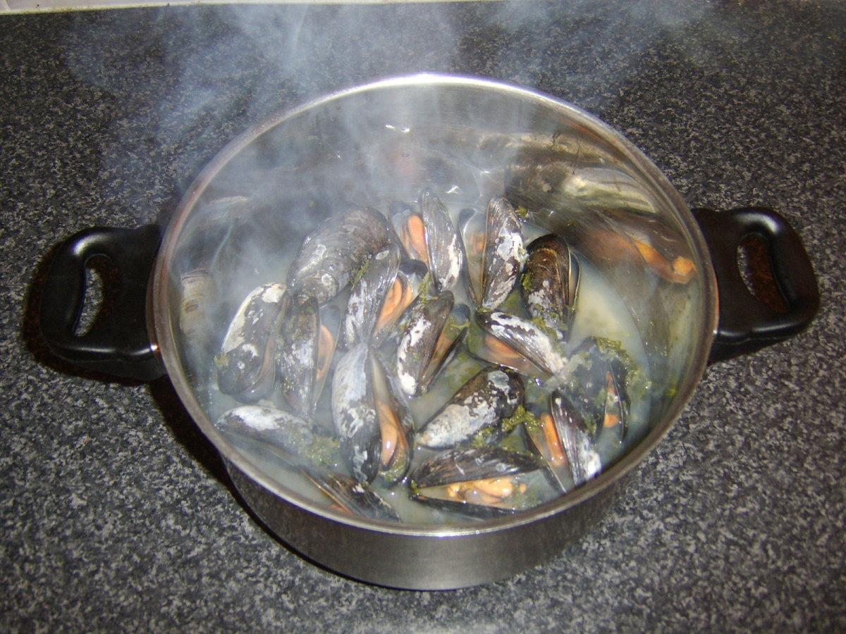 The steam from the boiling liquid should cause the mussels to cook and open in just a few minutes