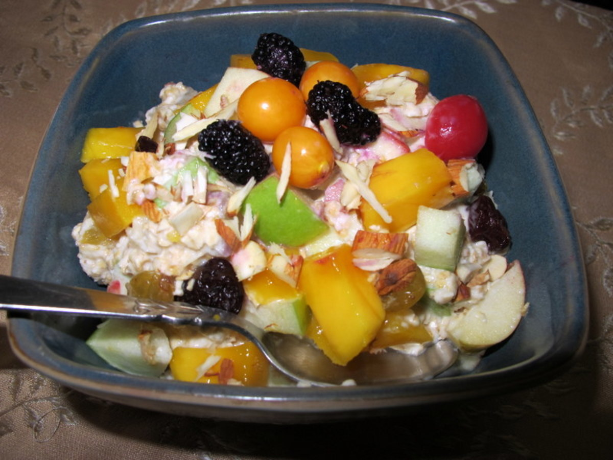 Make Bircher's Swiss muesli with any fruit you have on hand. Pictured: muesli with apples, mangoes, berries, and almond slivers.