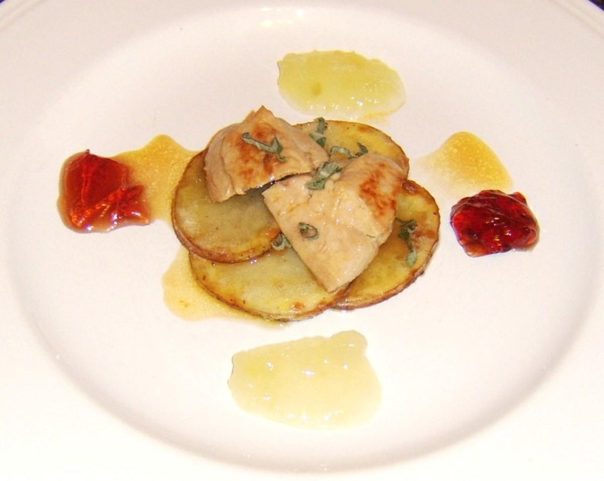 Partridge breast pan fried in herb butter and served on potato discs with cider sauce, applesauce and redcurrant jelly