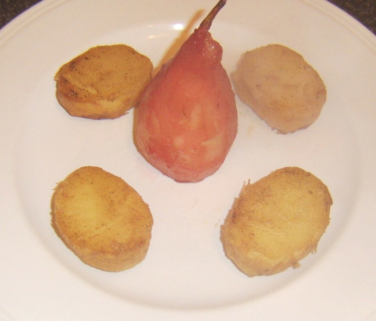 Poached pear is plated