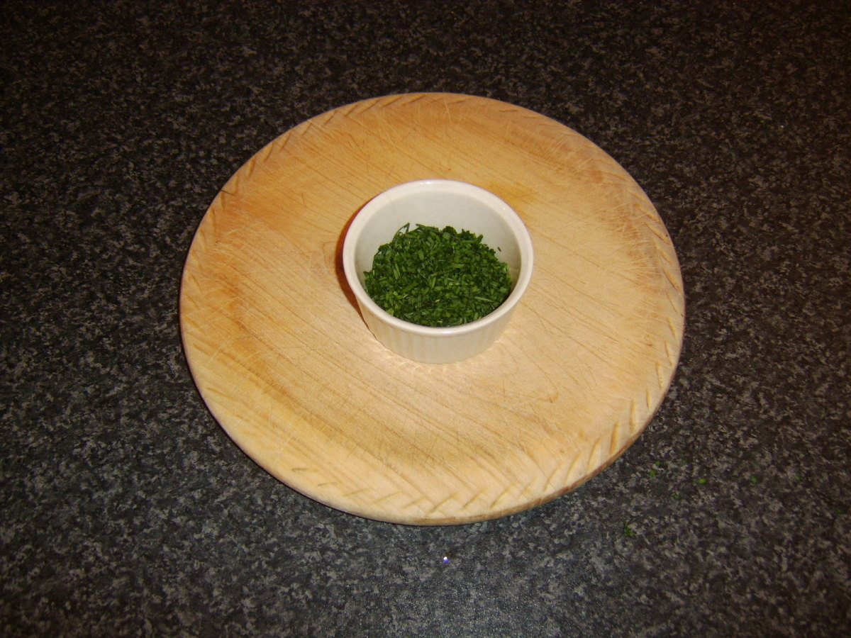 Chopped herbs in ramekin, ready for melted butter