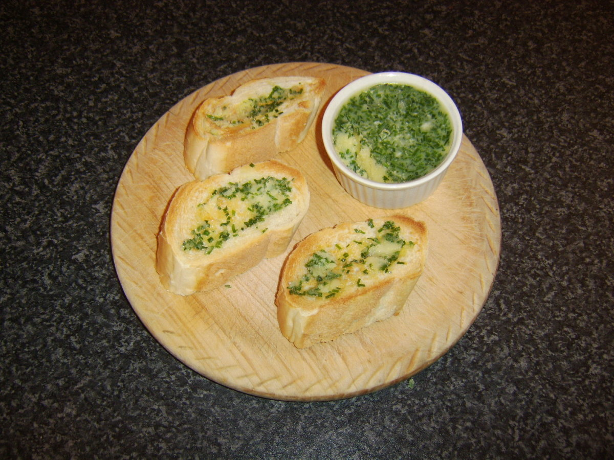 Chive and garlic herb butter is spread on hot toast