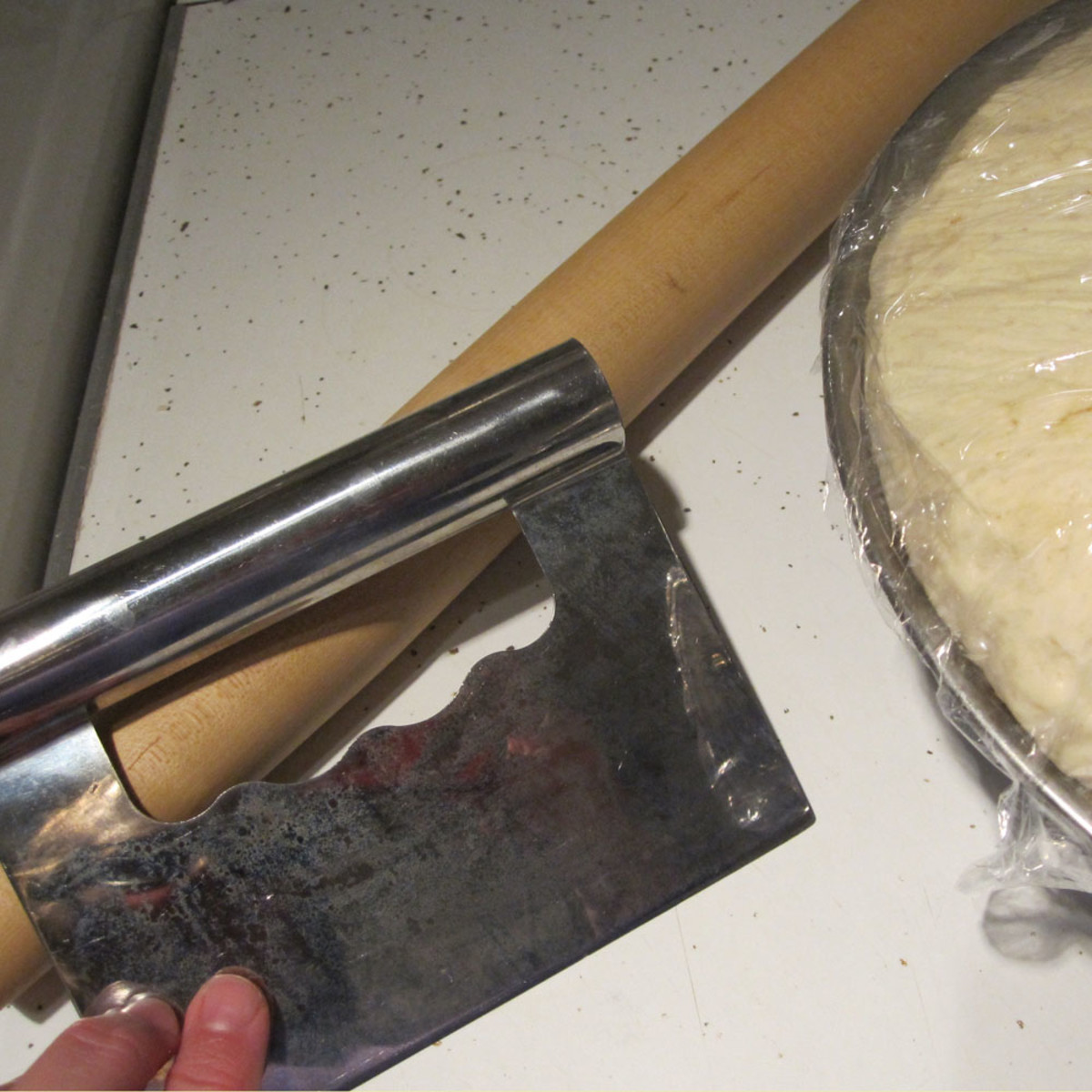Bench scraper/dough cutter and French rolling pin.