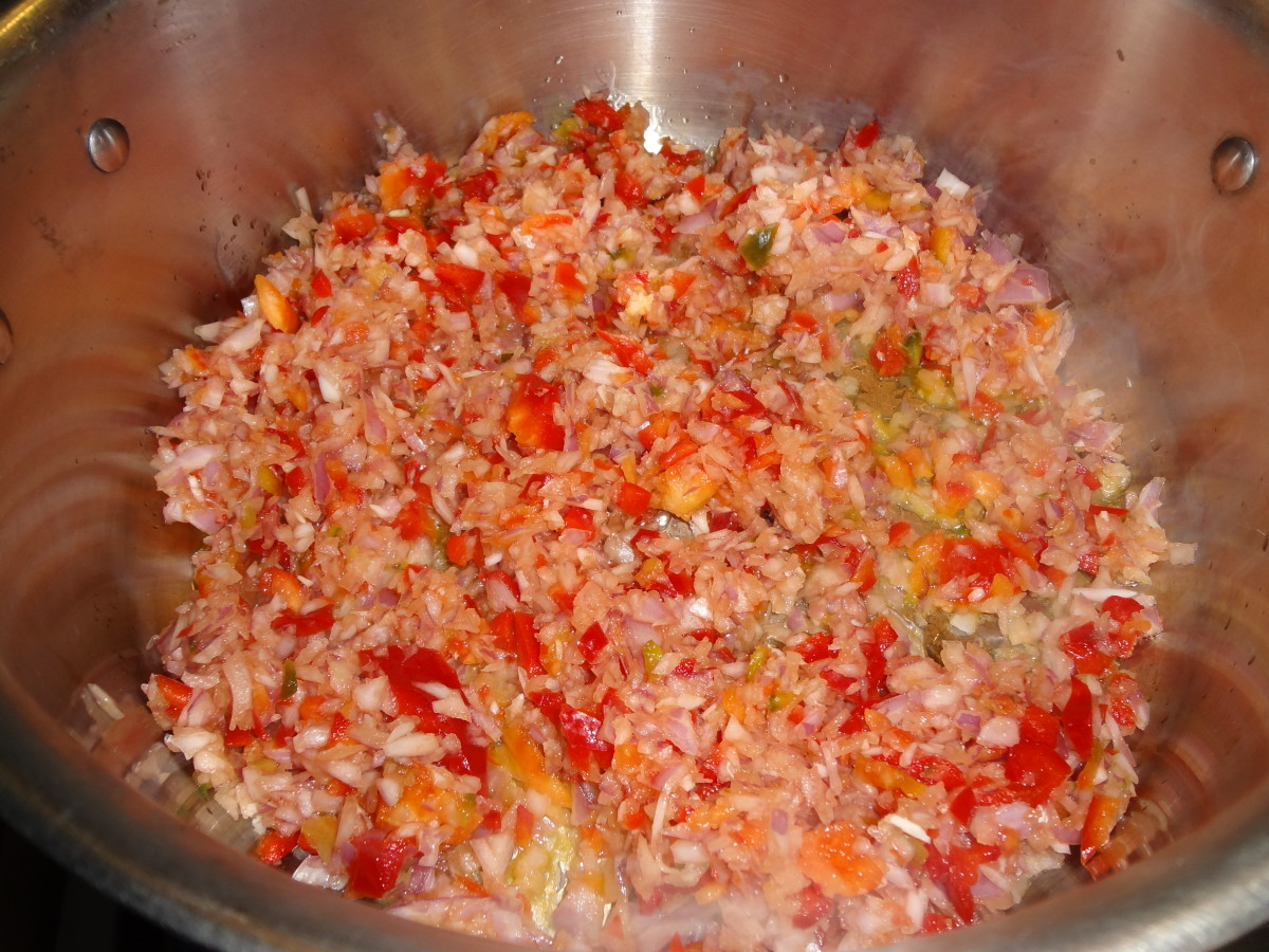 Saute the peppers, onion and garlic until translucent