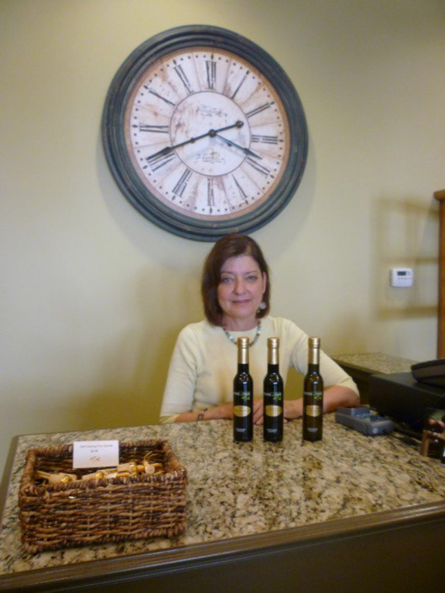 Susan Burt, co-owner of Olive & Vine, assisting us with our purchase on the first day of our visit.