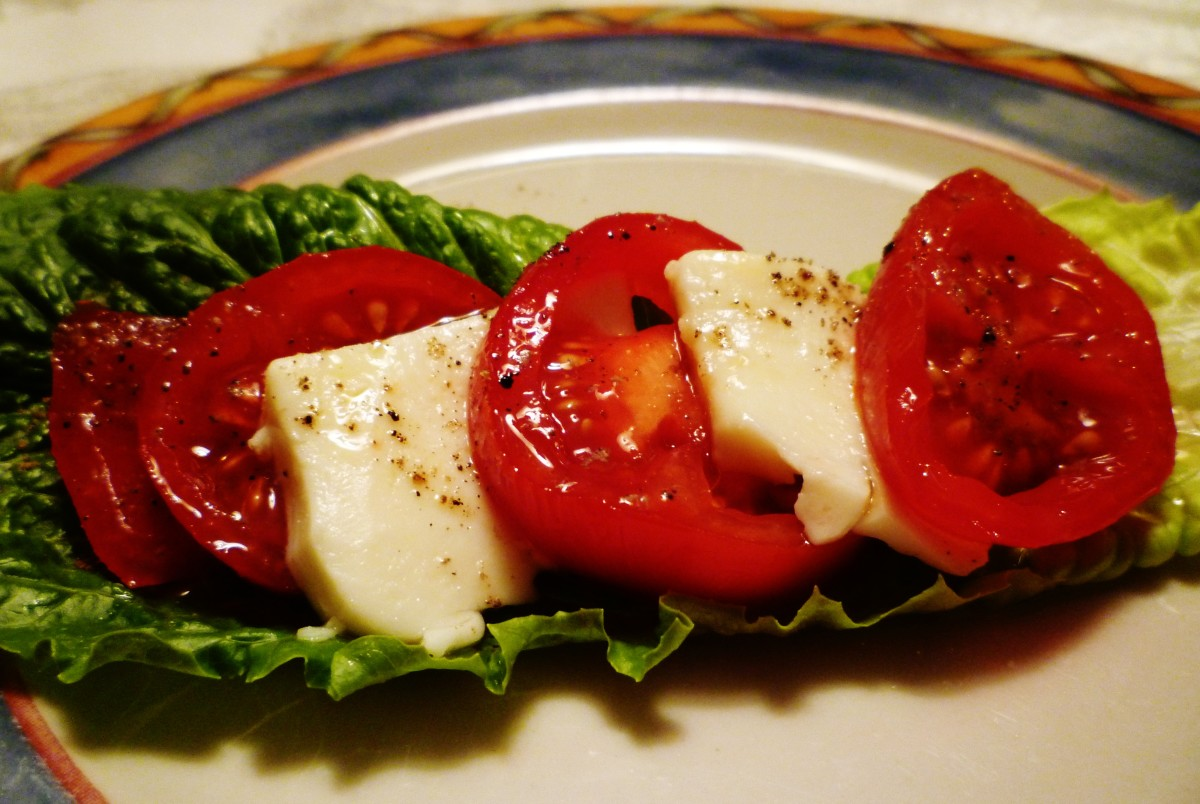 Salad Caprese -  Herbes de Provence EVOO drizzled over sliced tomatoes & fresh mozarella cheese.