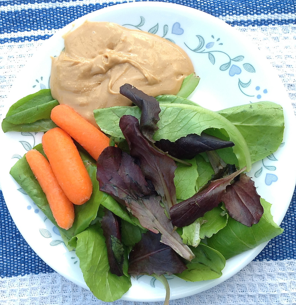 I include dark salad greens, carrots, and cashew butter in the smoothie.