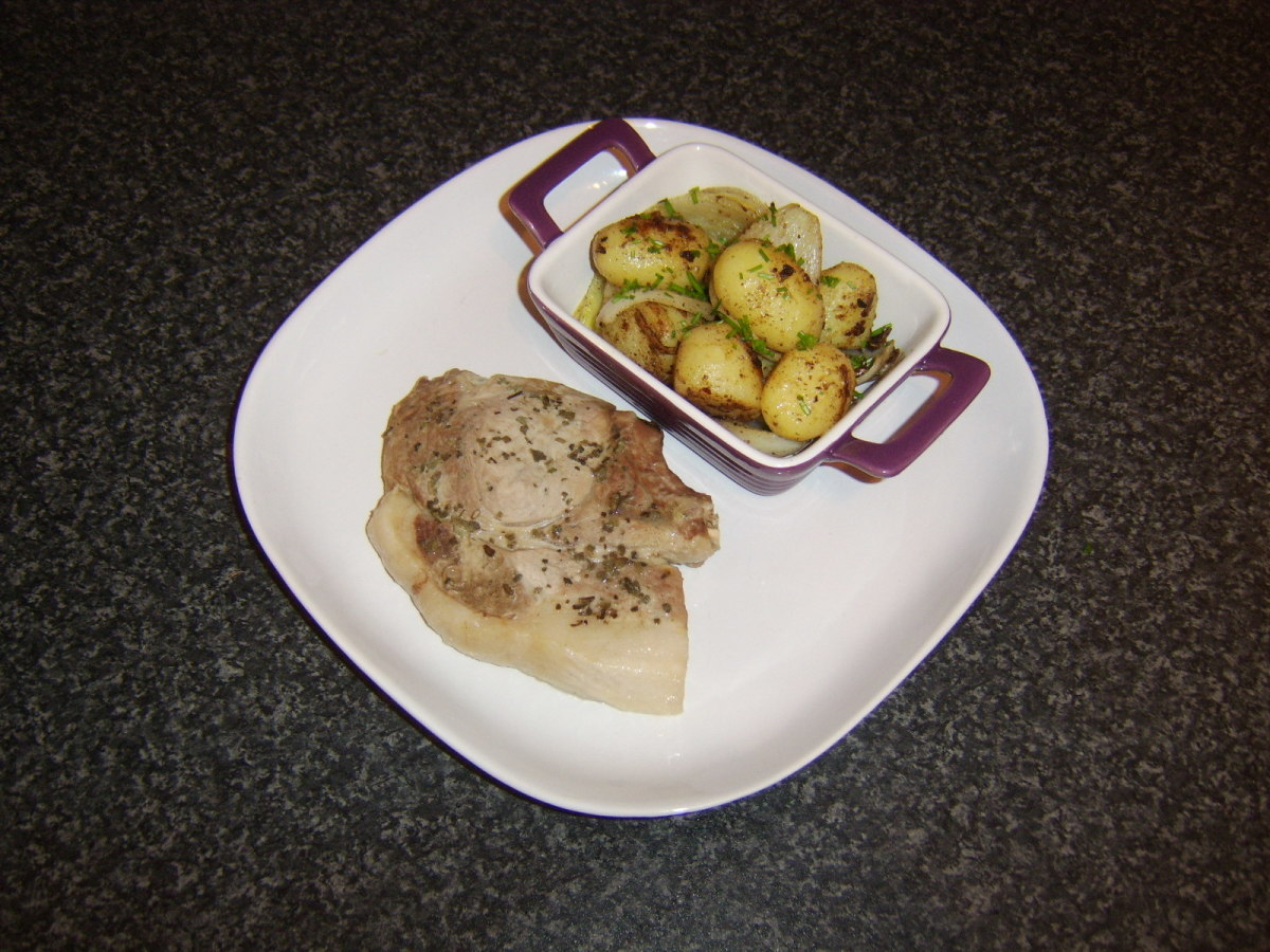 Pork chop and stir fry are plated