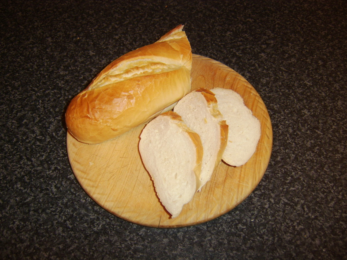 Bread is cut at an angle for bruschetta