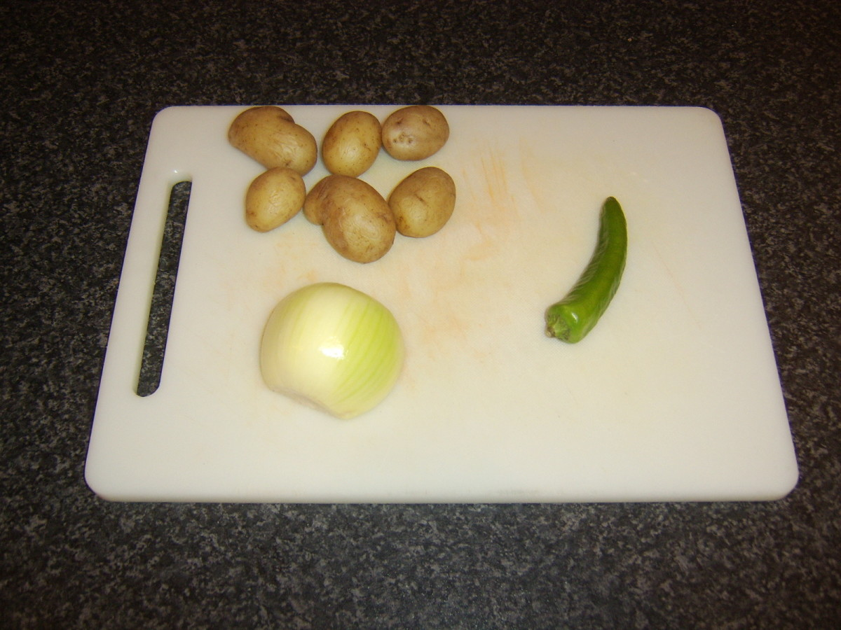 Cooked potatoes, onion and chilli for stir fry
