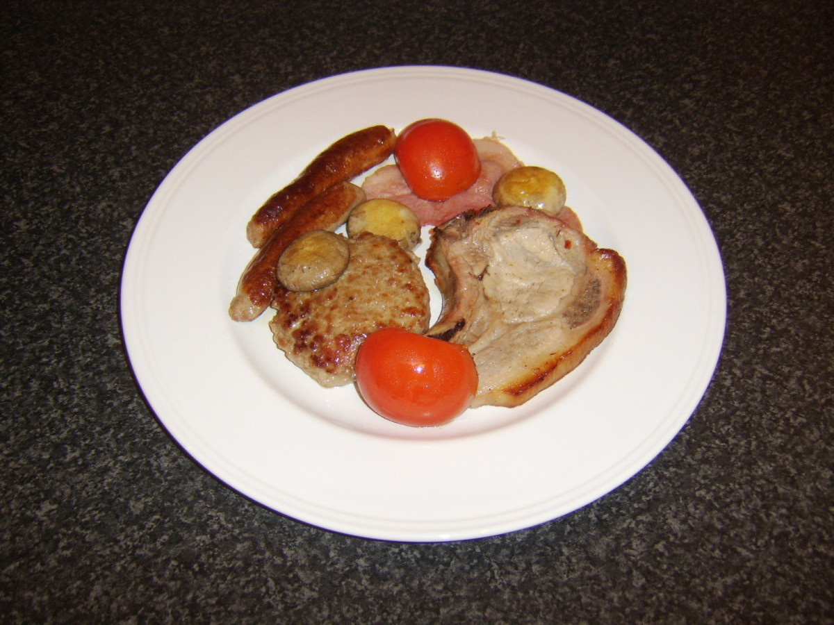 Oven roasted pork chop with pork burger, pork sausages and bacon