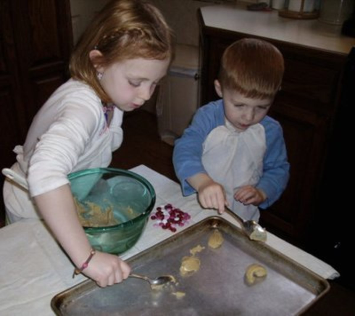 Put spoonsful of dough on the cookie sheet.