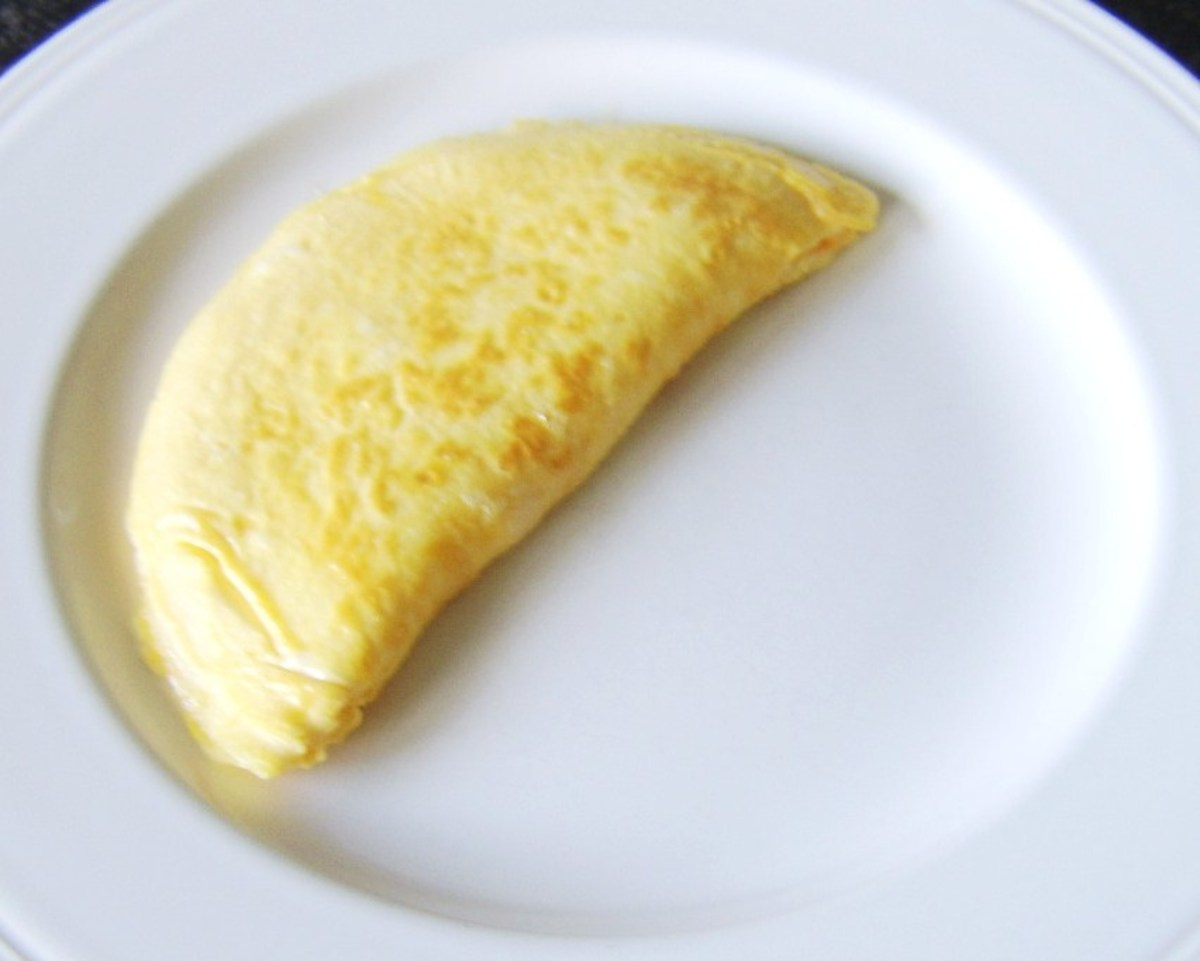 Cheesy duck egg omelette is plated