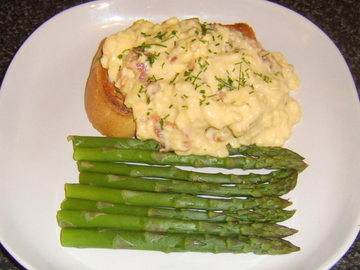 Smoked salmon is stirred through scrambled duck eggs which are served on toast and with steamed asparagus