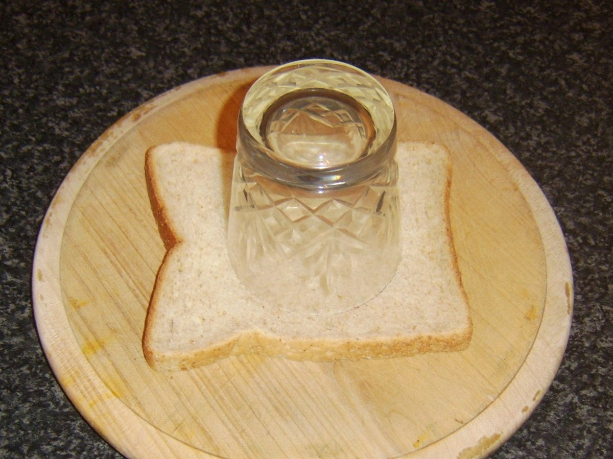 Cutting hole in bread with drinking glass