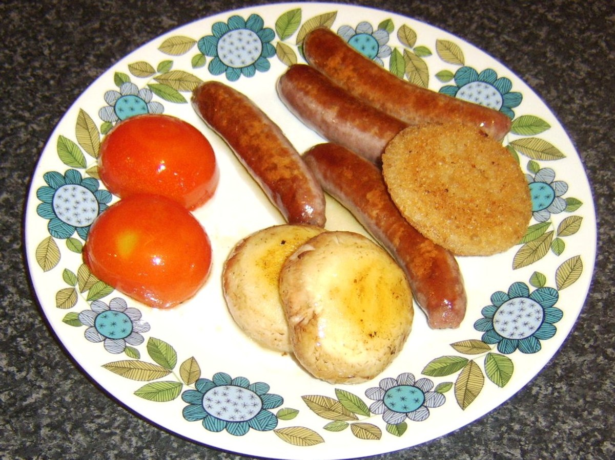 Sausages and sundries are transferred to warmed plate and covered with foil