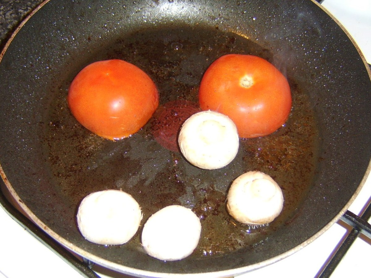 Frying tomato and mushrooms in steak juices