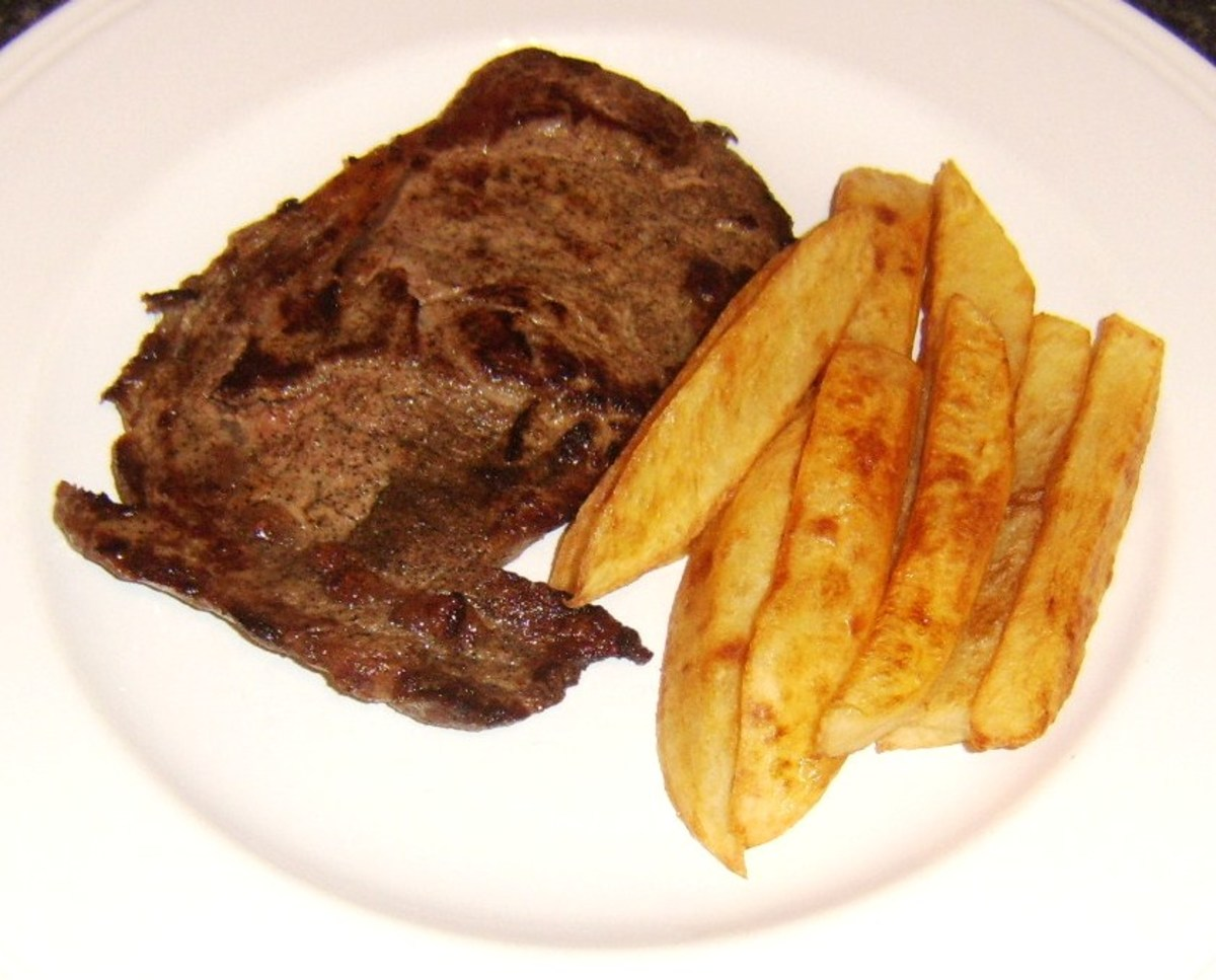 Steak and chips are plated first