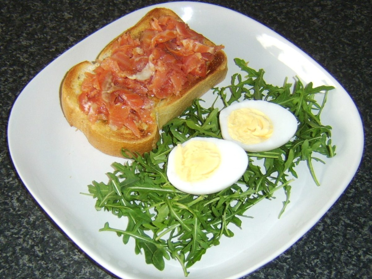 Smoked salmon and hard boiled duck egg are added to toast and salad
