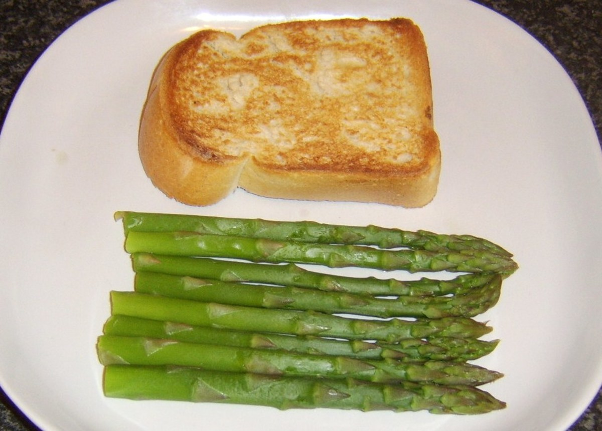 Toast and asparagus spears are plated