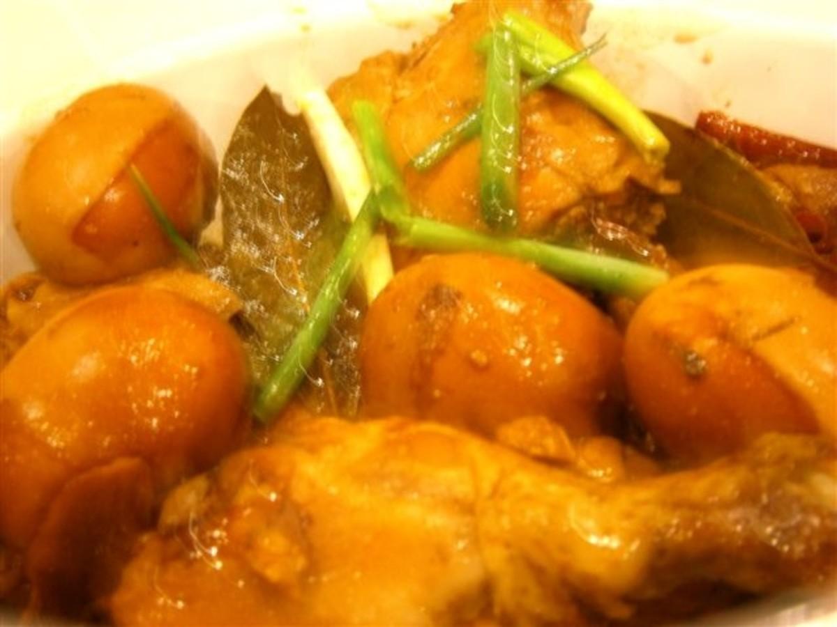 Chicken adobo seasoned with garlic, ginger, bay leaf, soya sauce and vinegar.