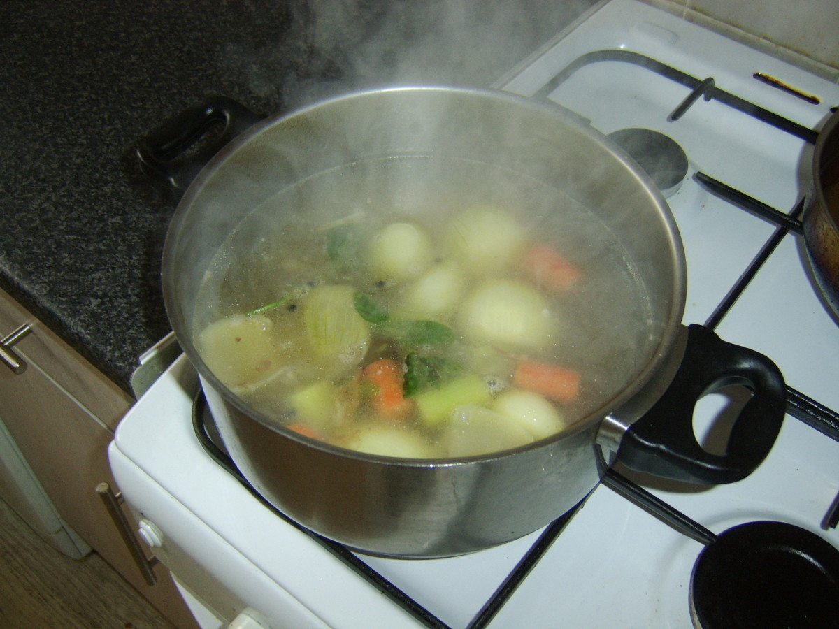 Water is added to stock pot and brought to a simmer
