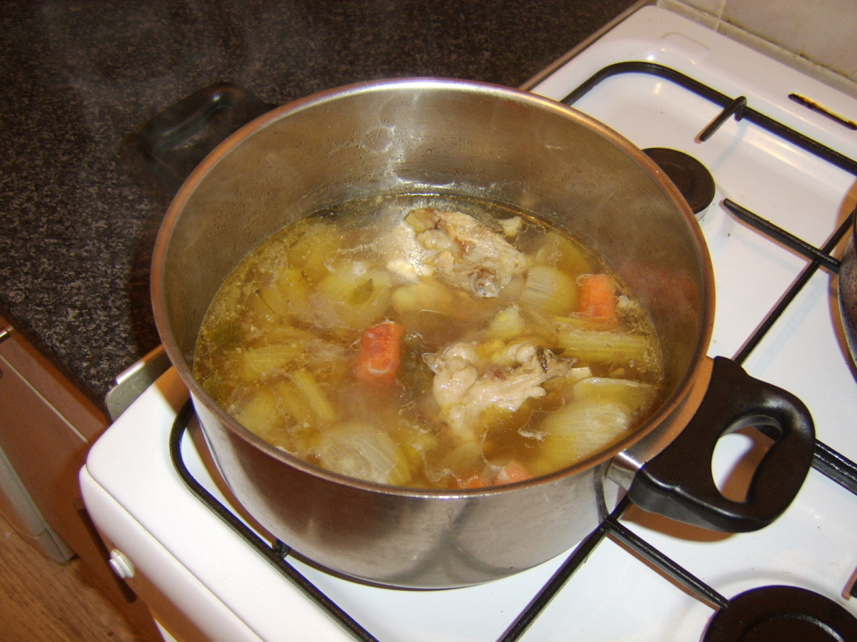 After two hours, the liquid in the lamb stock has been reduced by half