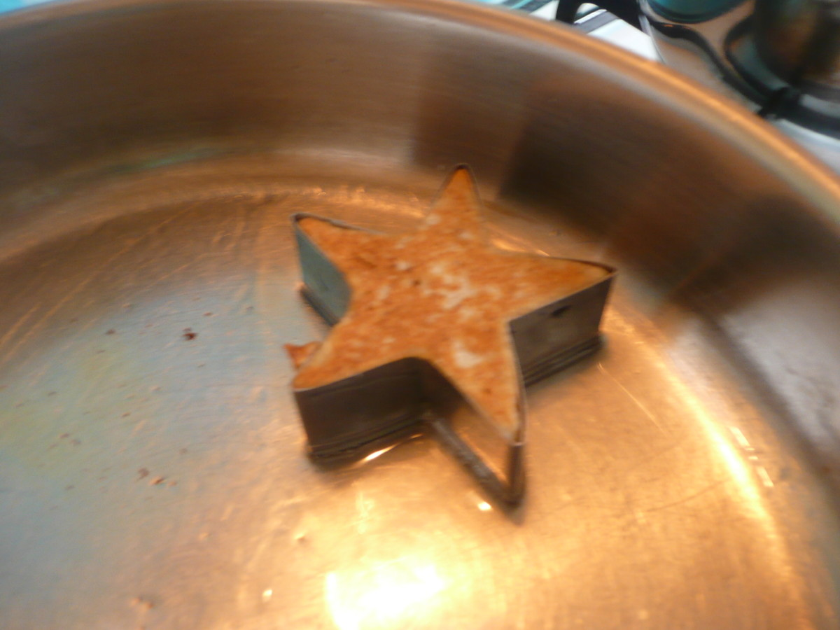 A star-shaped pancake in a mold.