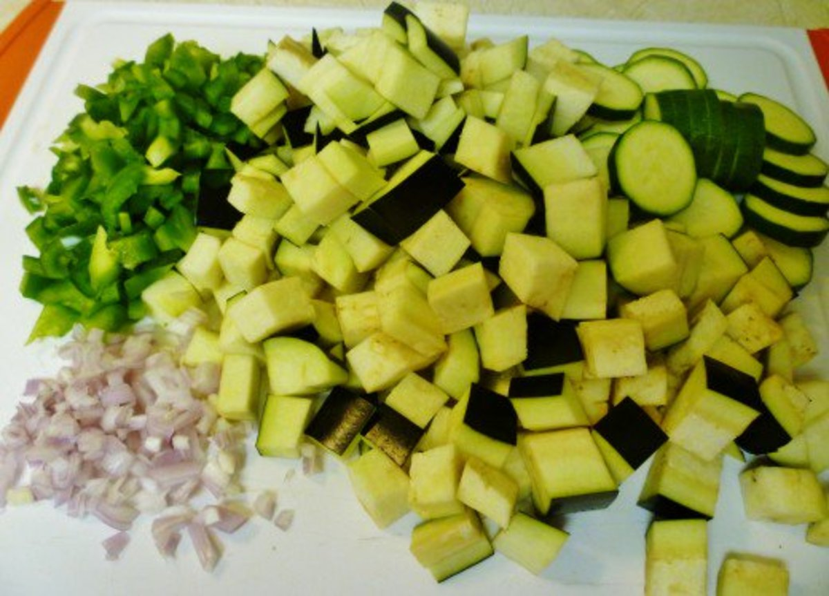 Cutting board with all of the veggies sliced, cubed and diced.