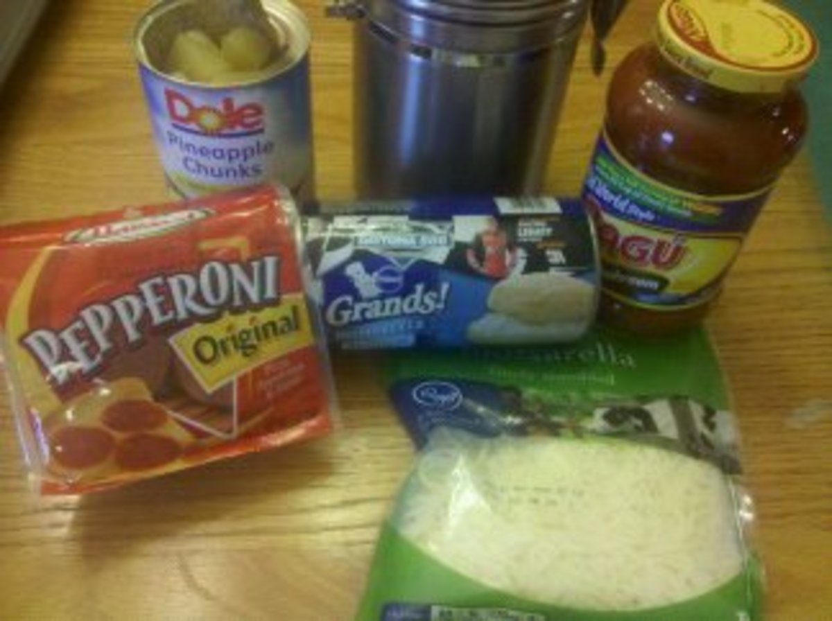Ingredients to make pepperoni and pineapple mini pizzas.