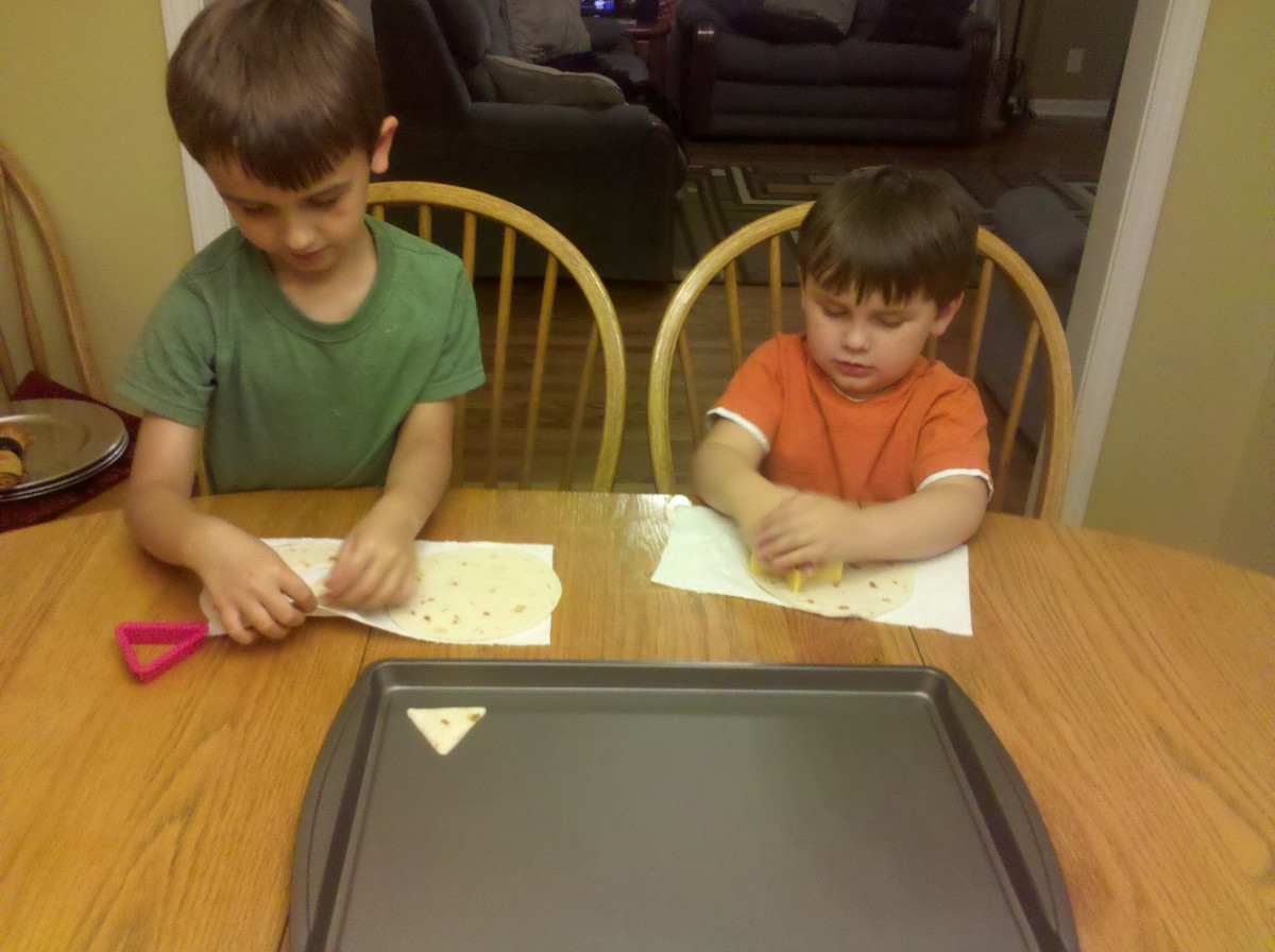 Cutting out shapes in the tortillas using cookie cutters.