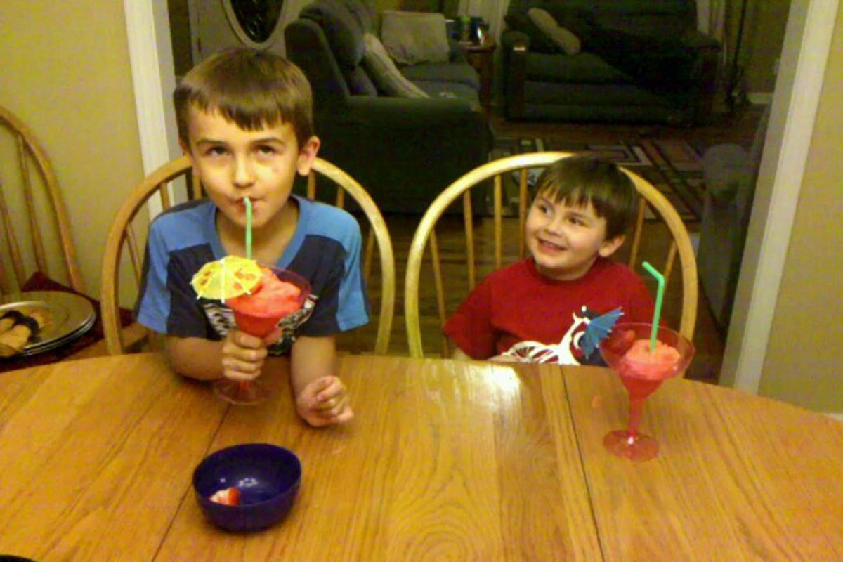 Enjoying their strawberry lemonade slush.