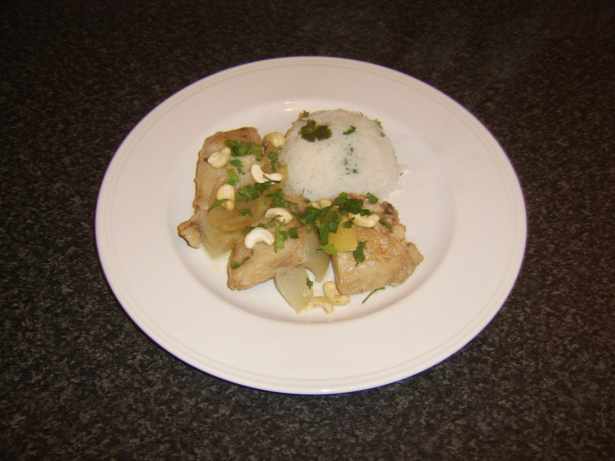 Chicken and pineapple casserole is served with cashew nuts and herb rice